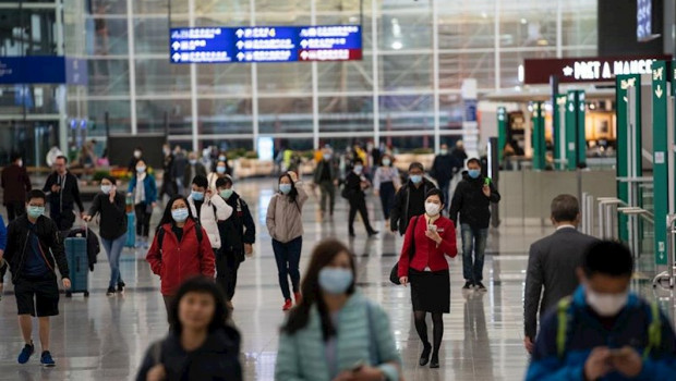 ep travellers and airline crew members are seen wearing surgical masks as a protective measure from